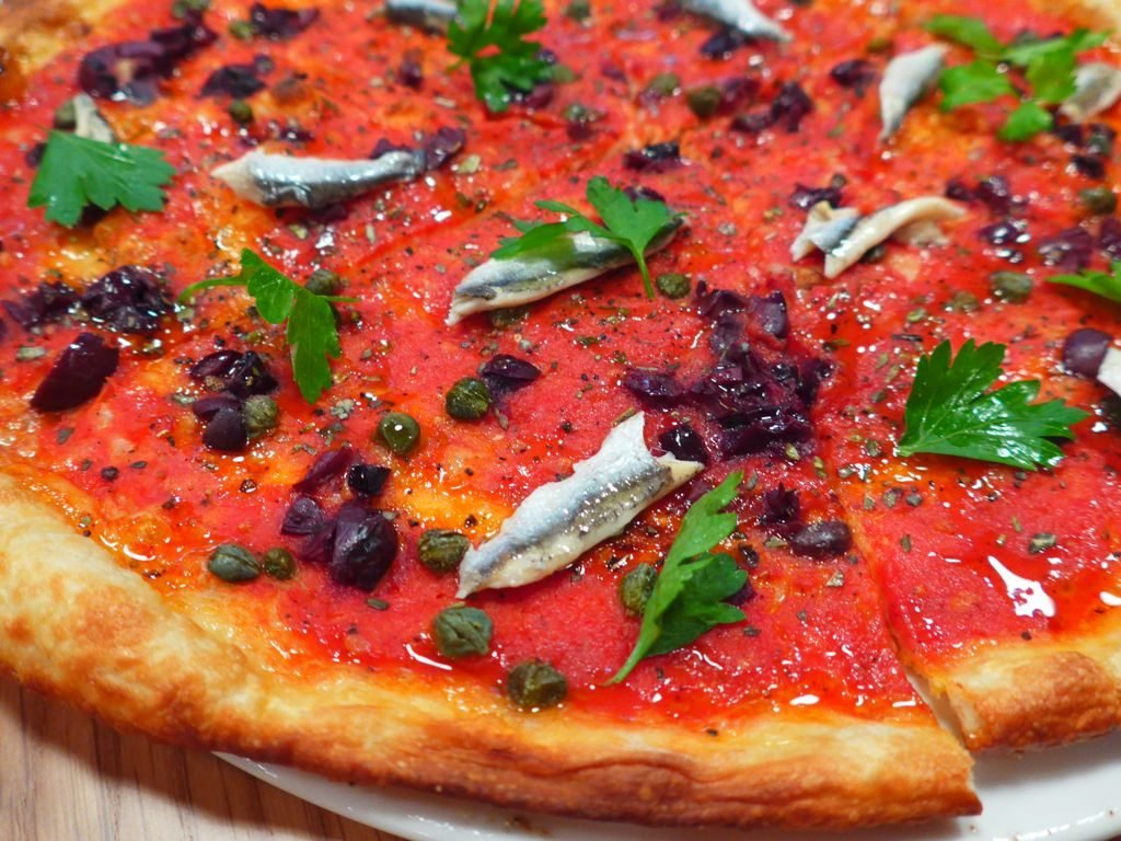 No Neapolitan here--pizzas are thin and crisp-crusted. Photograph by Anna Spiegel