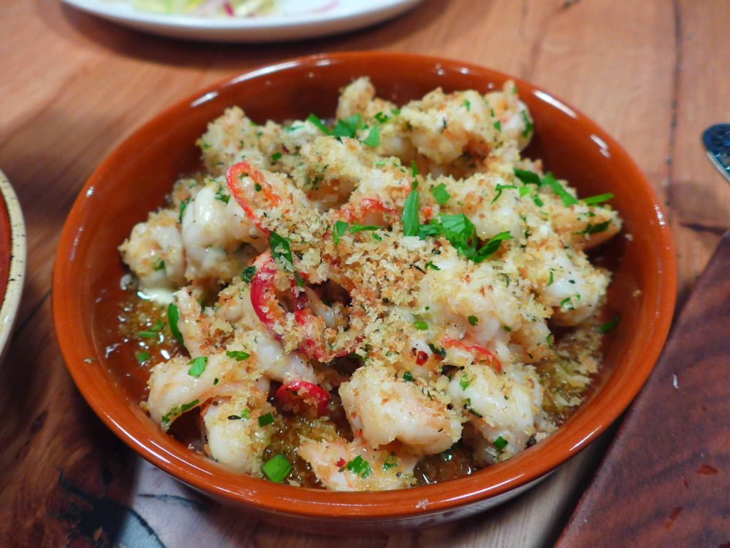 Antipasti include simple seafood and vegetable dishes like these shrimp with chilies and breadcrumbs. Photograph by Anna Spiegel