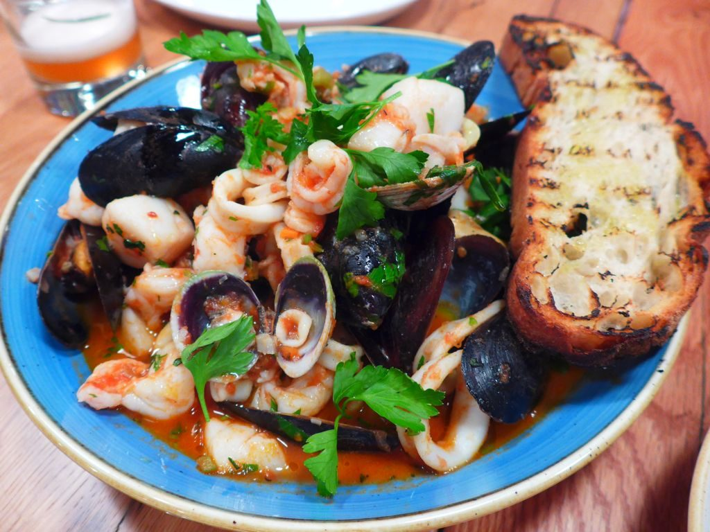 Seafood plays a large role on the menu, like this seafood stew with grilled bread. Photograph by Anna Spiegel