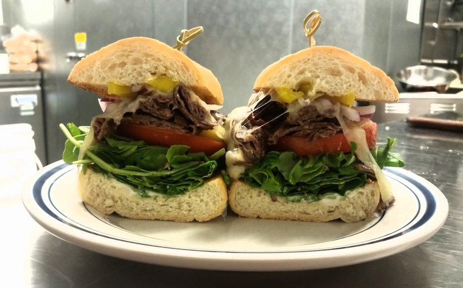 Duke's Counter serves up towering sandwiches, like the Taken with Liberty (ribeye, garlic aioli, peppers) across from the National Zoo. Photograph courtesy of Duke's