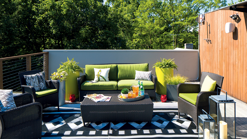 Patio furniture from Crate & Barrel and CB2 keep the outside area of this Arlington roof deck modern and fresh. Photographs by Dan Chung.