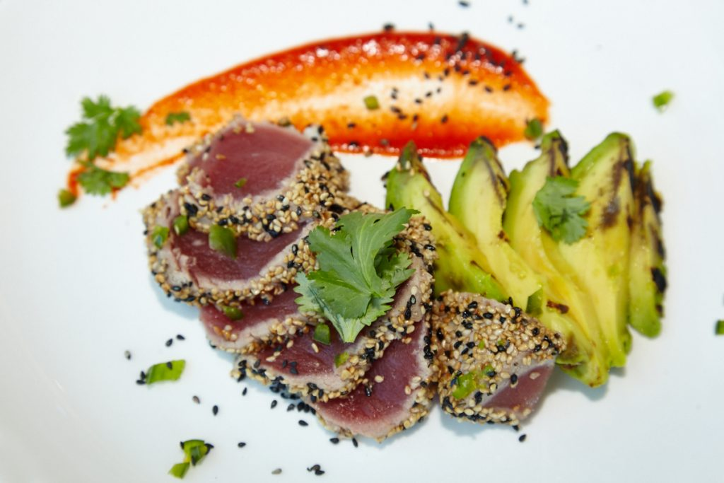 Chef Jonathan Kushner creates island-inspired dishes, such as sesame-crusted tuna with grilled avocado.