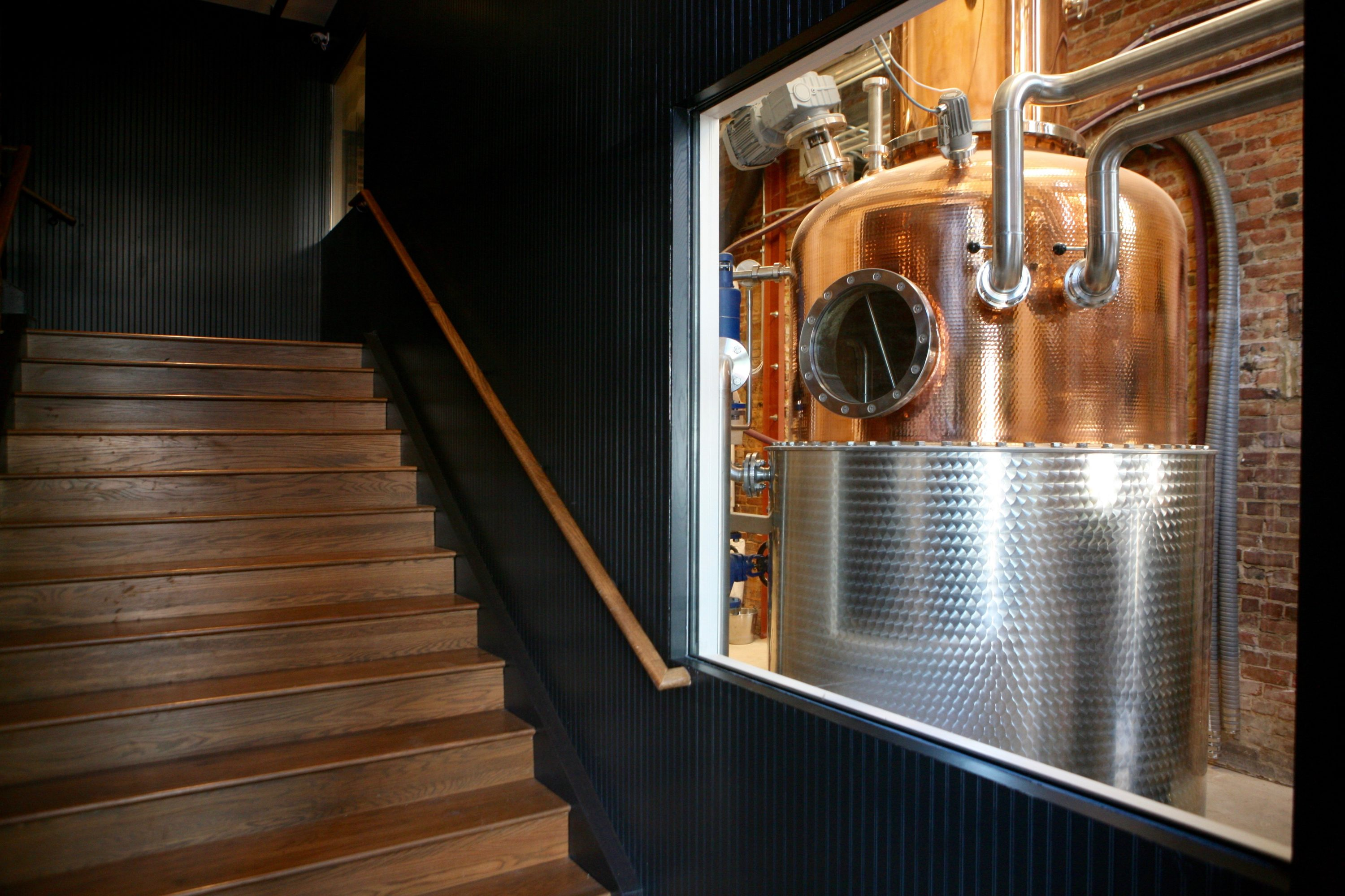 Guests glimpse the distilling equipment as soon as they walk in the door. Photography by Evy Mages.