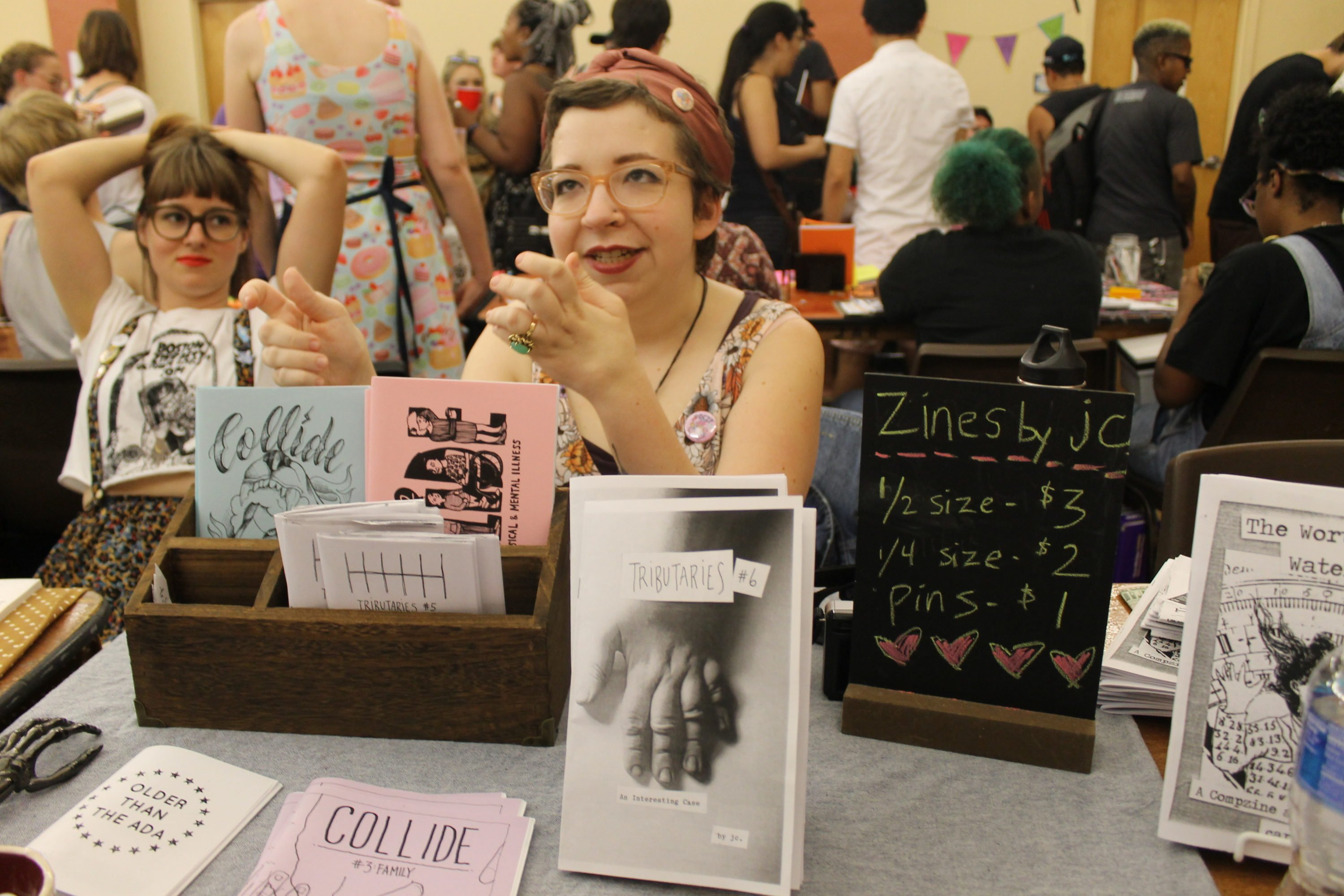 "JC Parker talking about her zine ""Tributaries"" at Zinefest. Photo by Greta Weber."