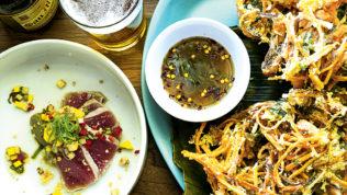 Kinilaw (tuna, avocado, chilis) and Ukoy (freshwater shrimp fritters, sweet potato, leeks) at Bad Saint. Photograph by Scott Suchman.