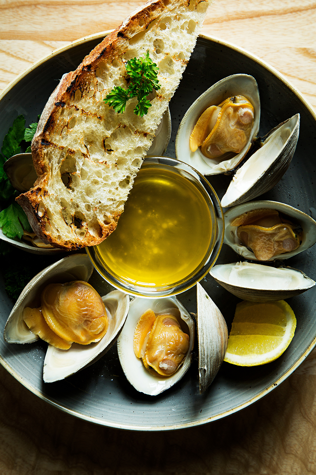 Steamed clams with butter. Photograph by Scott Suchman.