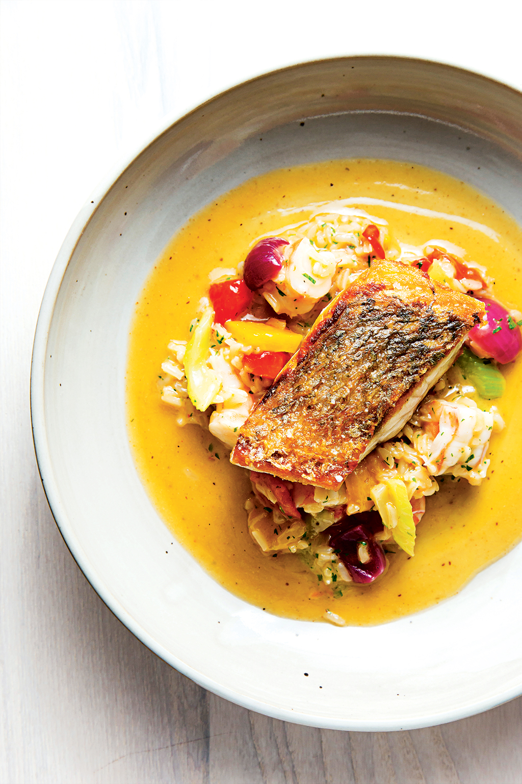 At Kinship, redfish sits atop shrimp jambalaya seasoned with Old Bay.