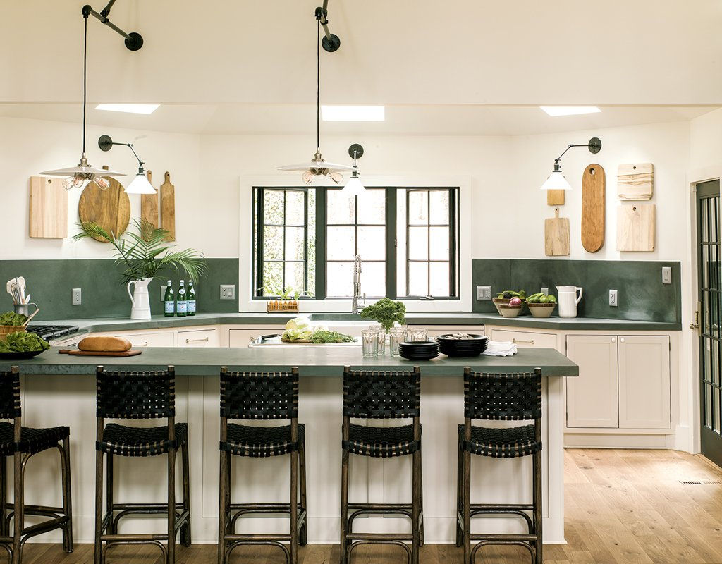 this designer s lake house is the retreat you ve always dreamed of removing upper cabinets made the kitchen feel much larger in their place liess hung