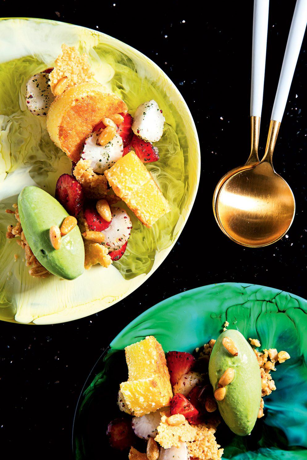 A dessert of pecorino cake with basil gelato and strawberries.
