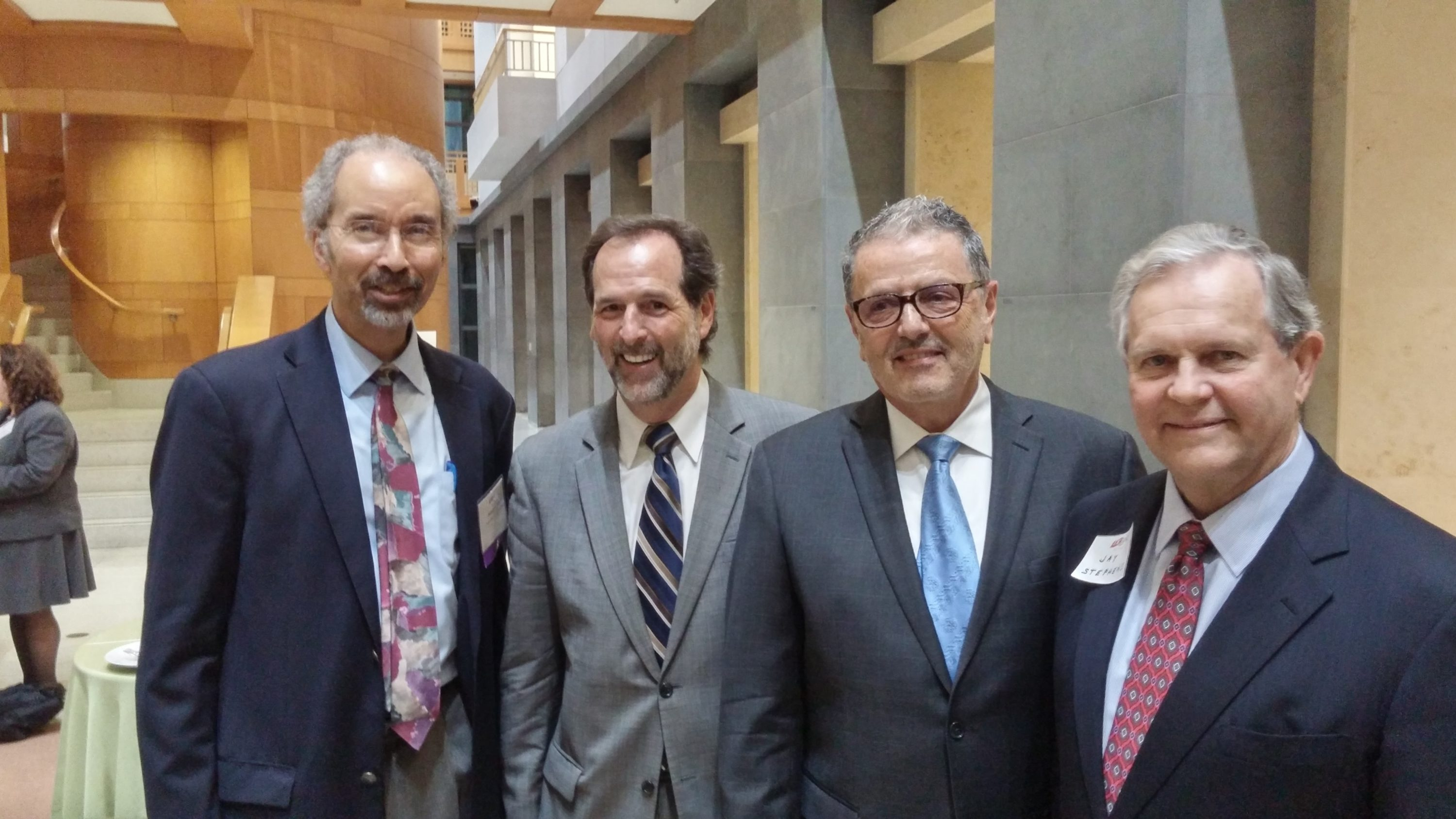 Roberts at a DC Bar reception this past spring, with, left to right, lawyers Howard Katzoff and Thomas Abbenante, and former DC US Attorney Jay Stephens. Photograph by Jeffery Leon, DC Bar.