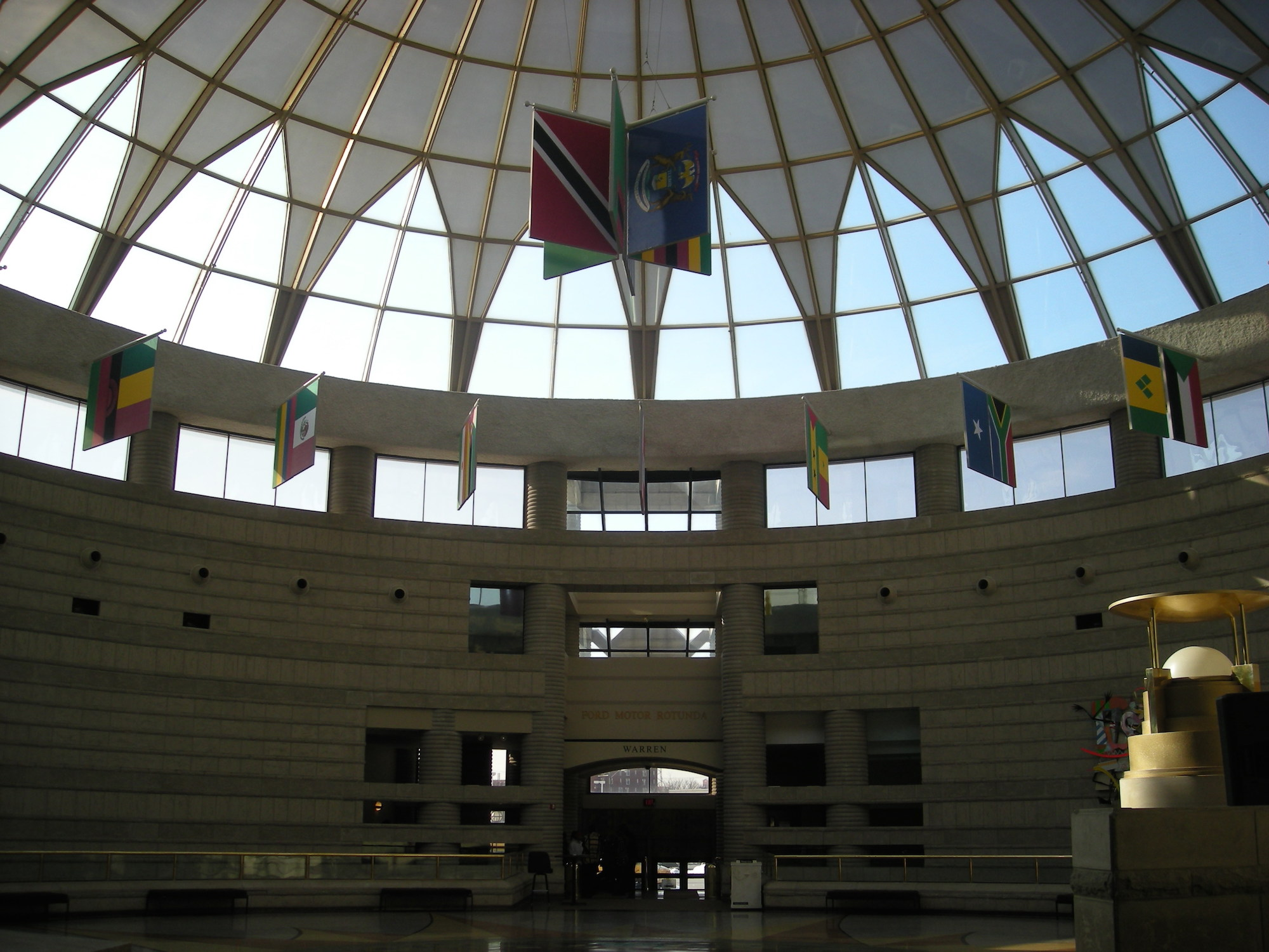 Ford Freedom Rotunda displaying 92 flags representing countries historically involved in the Atlantic slave trade. Photograph by Michael Barera \via wikimedia commons