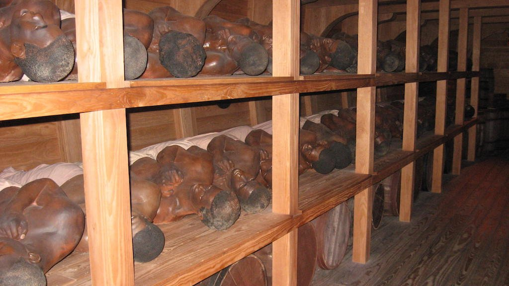 Wax figures represent slaves in the hull of the model slave ship in Detroit. Photograph courtesy of the Wright Museum.
