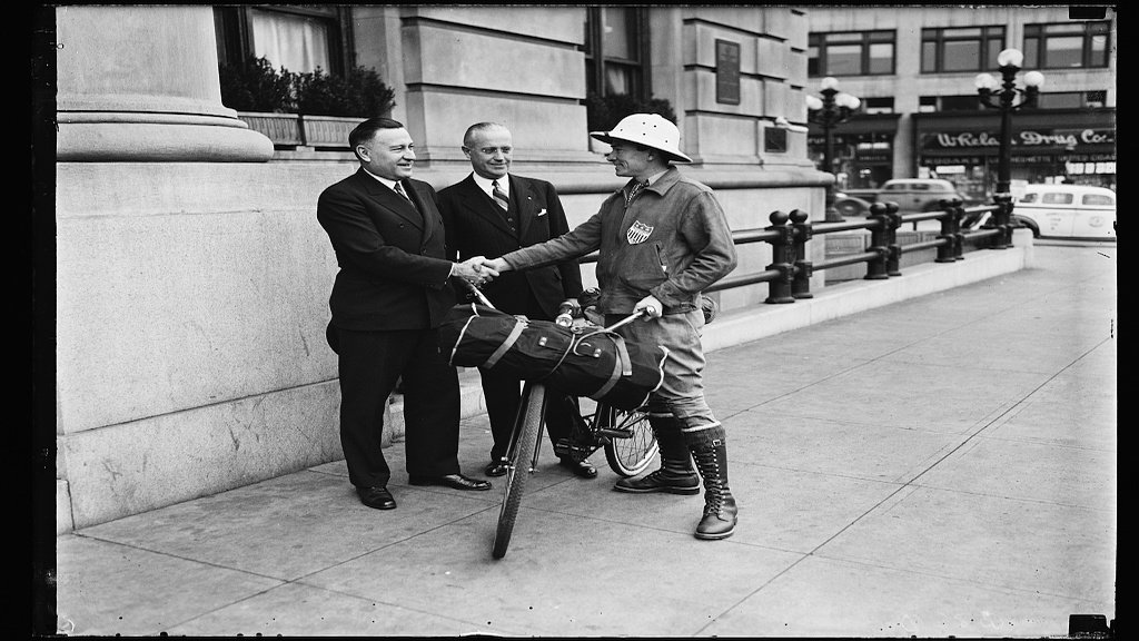 Washingtonian Henry G. Slaughter (right) meets with Charles M. Upham (left), Engineer and Director of the American Road Builders Ass'n. and H.F. Summerville (center), Managing Director of the Willard Hotel, before his international bike ride to promote the Inter- American highway in 1935. Photograph by Harris & Ewing