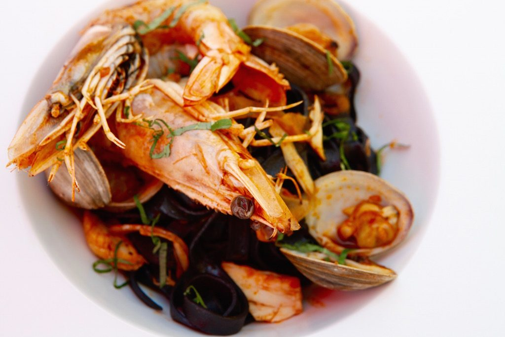 The kitchen offers plenty beyond pizza, like this squid ink pasta with seafood.