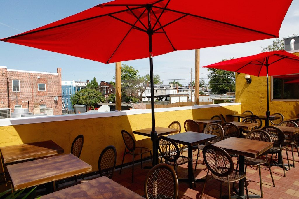 Patrons can order their pies on the rooftop, shaded with umbrellas.