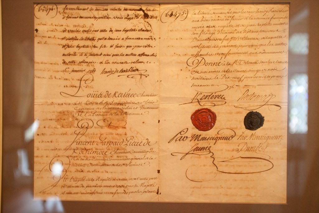 Original Manumission Paper for Francoise Amedee and her 10-year old son signed by Governor Louis Kerlerec in 1751. Photograph courtesy of Le Musée de f.p.c.
