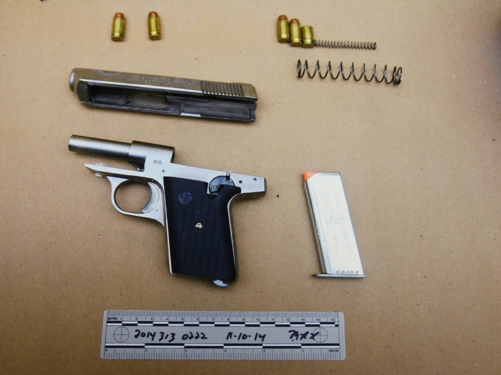 photograph-of-gun-parts-and-ammunition-found-in-bag-copy