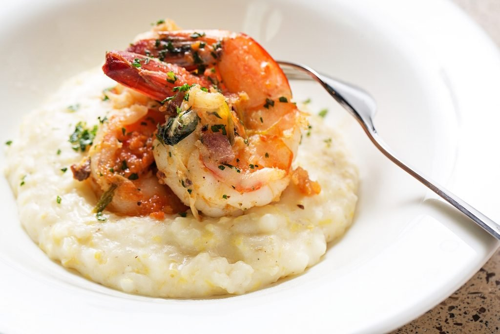 Familiar favorites like shrimp and grits and pulled pork sandwiches are offered alongside less-known specialties.