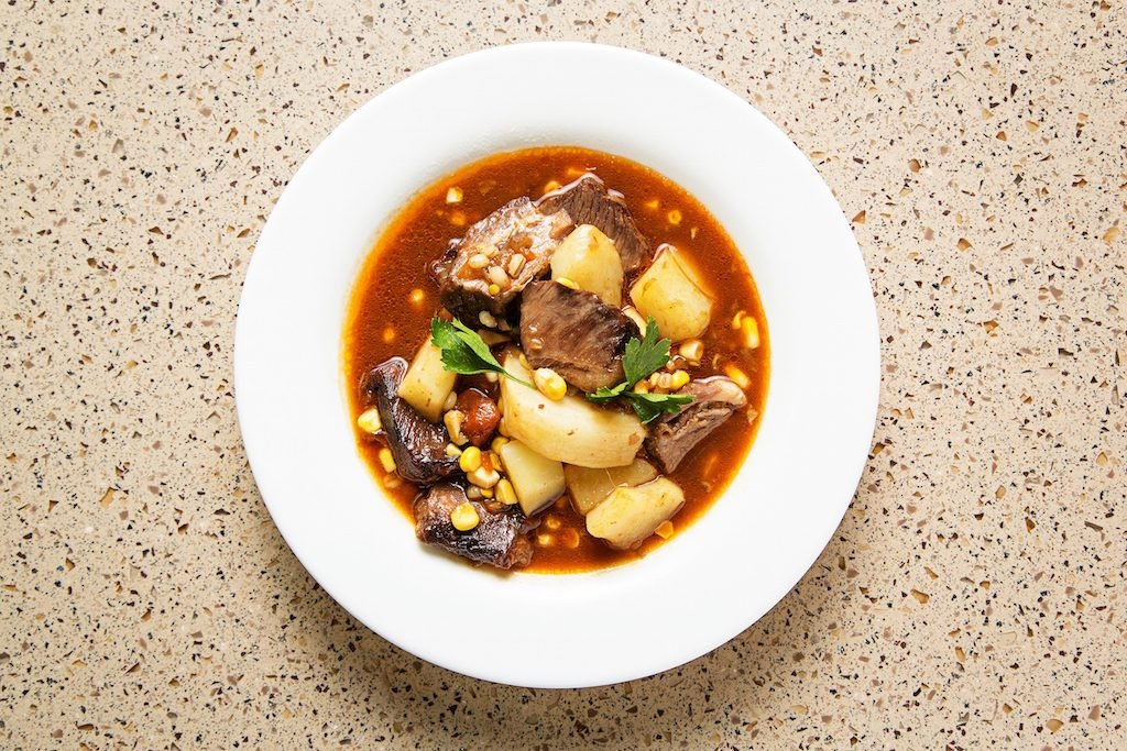 """Son of a gun"" stew from the Western Range inspired by African American cowboys, filled with braised meat, potatoes, and vegetables."