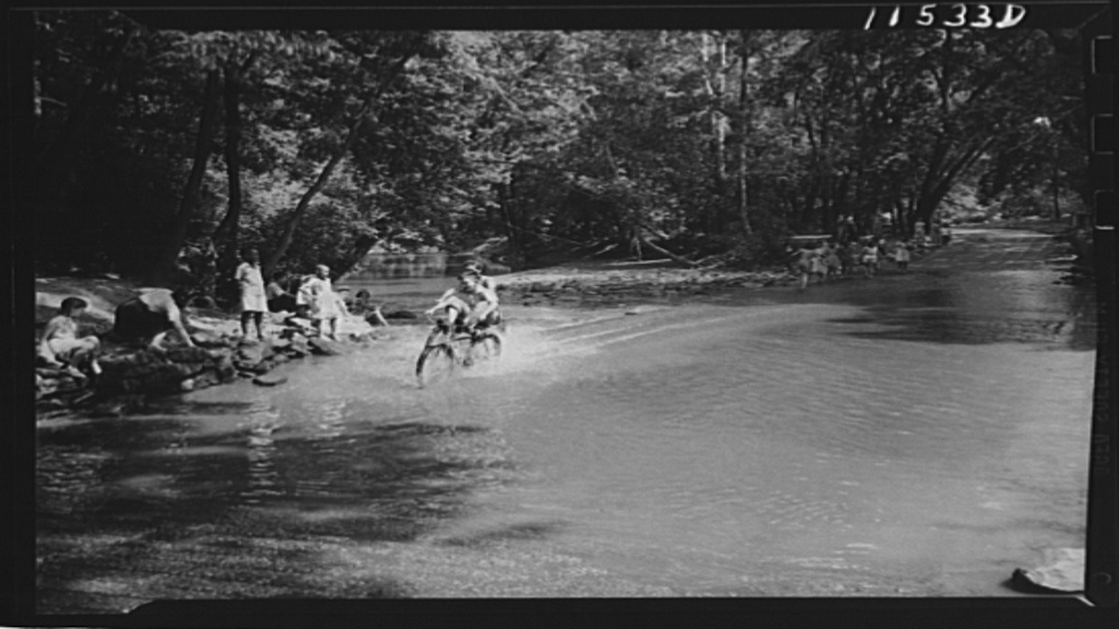 Boys ride bikes at Rock Creek Park, May 1942. Photograph by John Ferrell