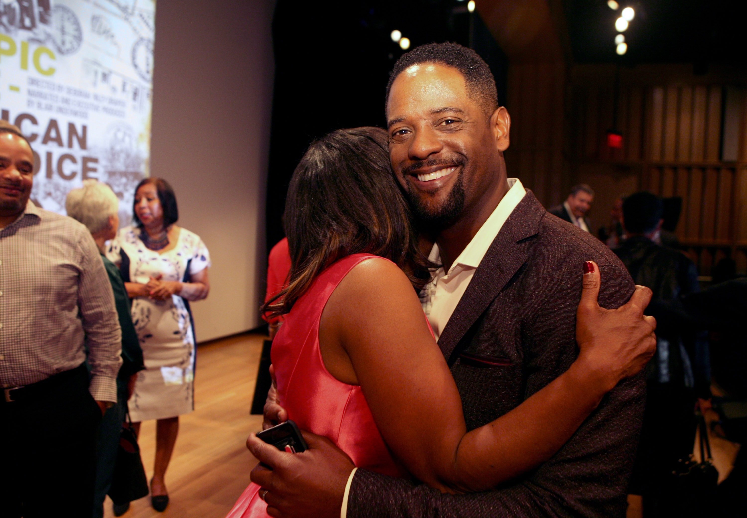 Blair Underwood, Narrator and Executive Producer hugs Director Deborah Riley Draper after the screening.