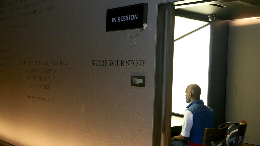 Black Lives Matter organizer DeRay McKesson shares his story in one of the Smithsonian's recording booths. Photograph by Evy Mages.