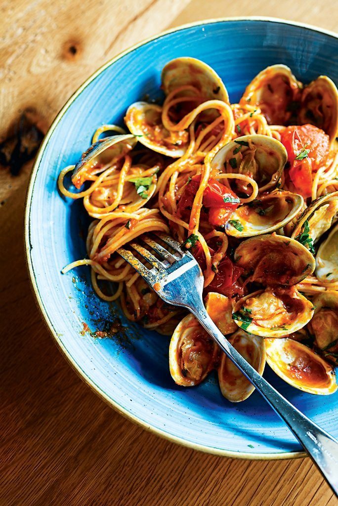 The thin strands of pasta are tossed with tomatoes and briny clams at Casolare.