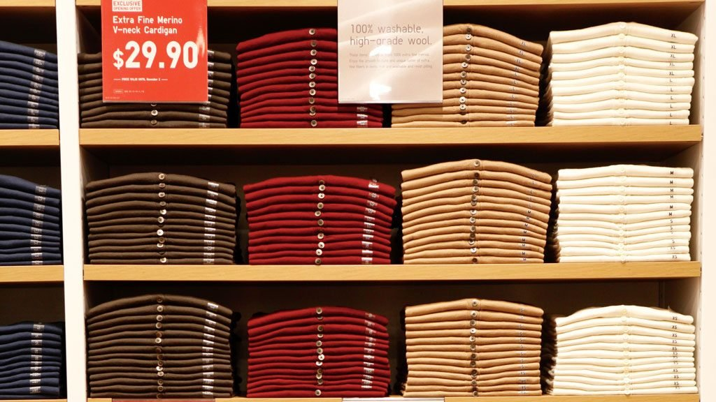 Sweater wall at Uniqlo. Photograph by Evy Mages.
