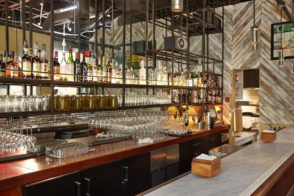 Design features from the Cashion's Eat Place days persist at the new Johnny's, including an elevated bar.