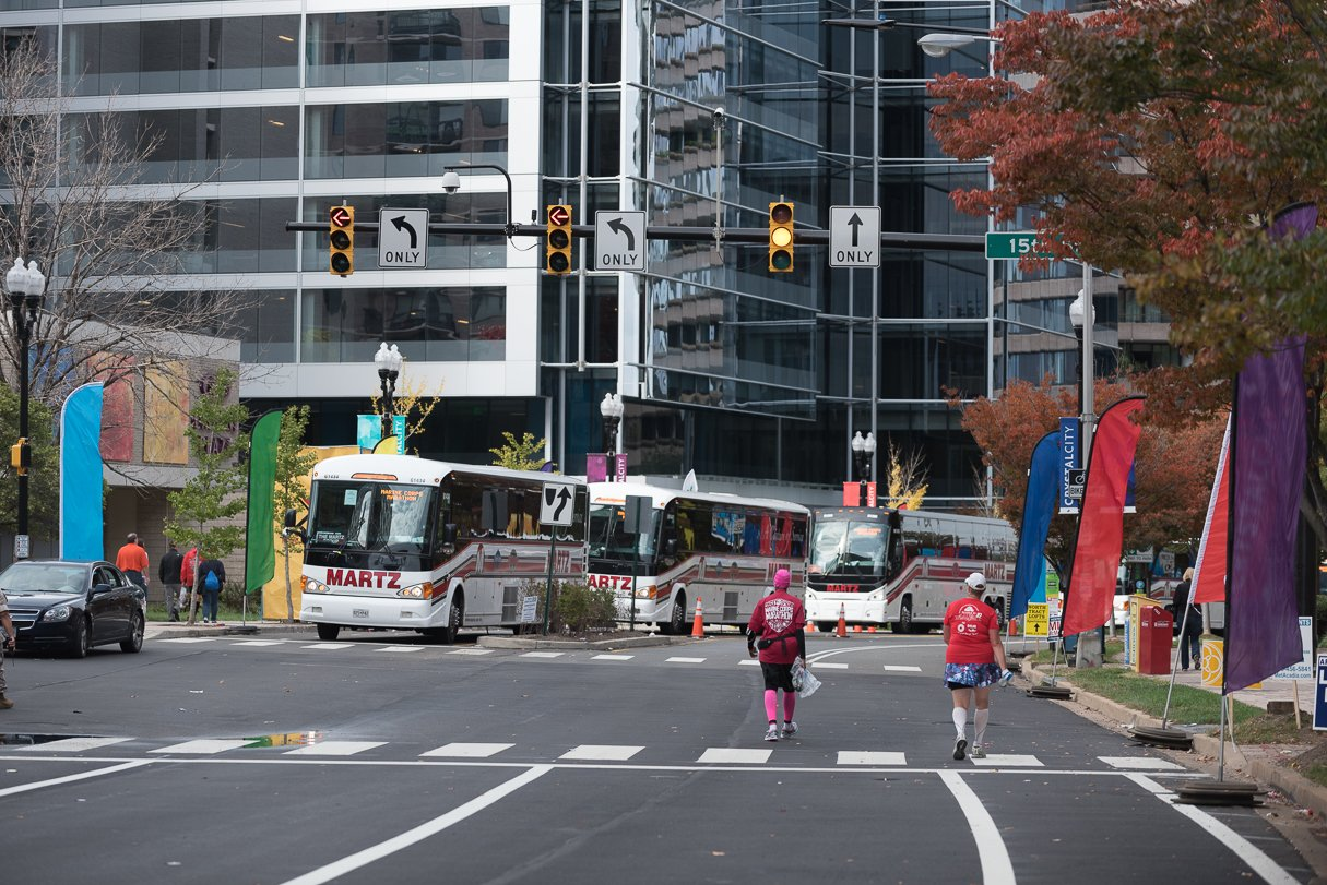 The four straggler buses that pick up the unlucky ones—those too slow to finish—wait at 15th Street and Crystal Drive in the Crystal City section of Arlington around mile 22.