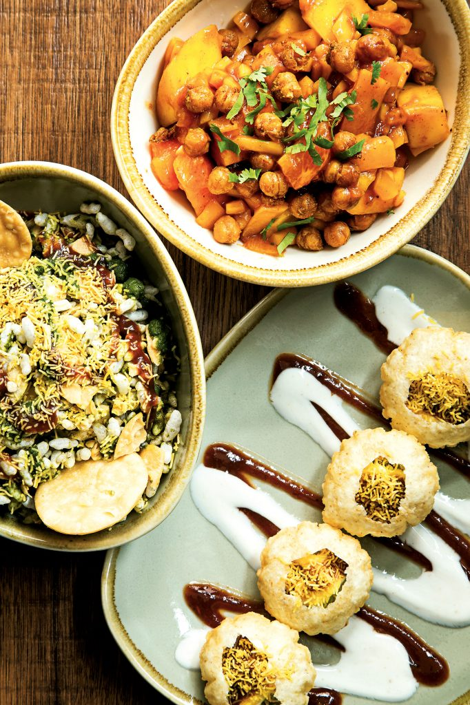 Clockwise from the top: a tropical-fruit salad, avocado golgappas, and bhel puri, a puffed-rice salad. Photo by Scott Suchman.