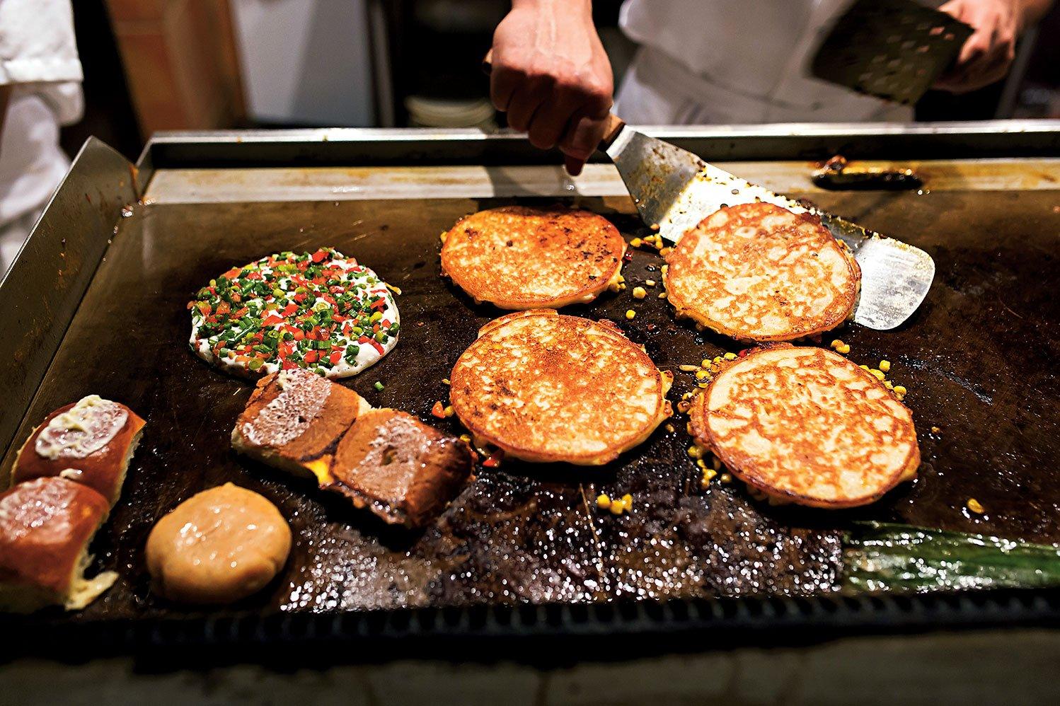 Uttapams on the griddle. Photo by Scott Suchman.