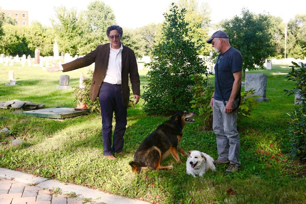 Guy Palace (left) with a Congressional Cemetery dog walker at the site of Charles Siegert's grave. Photo by Evy Mages.