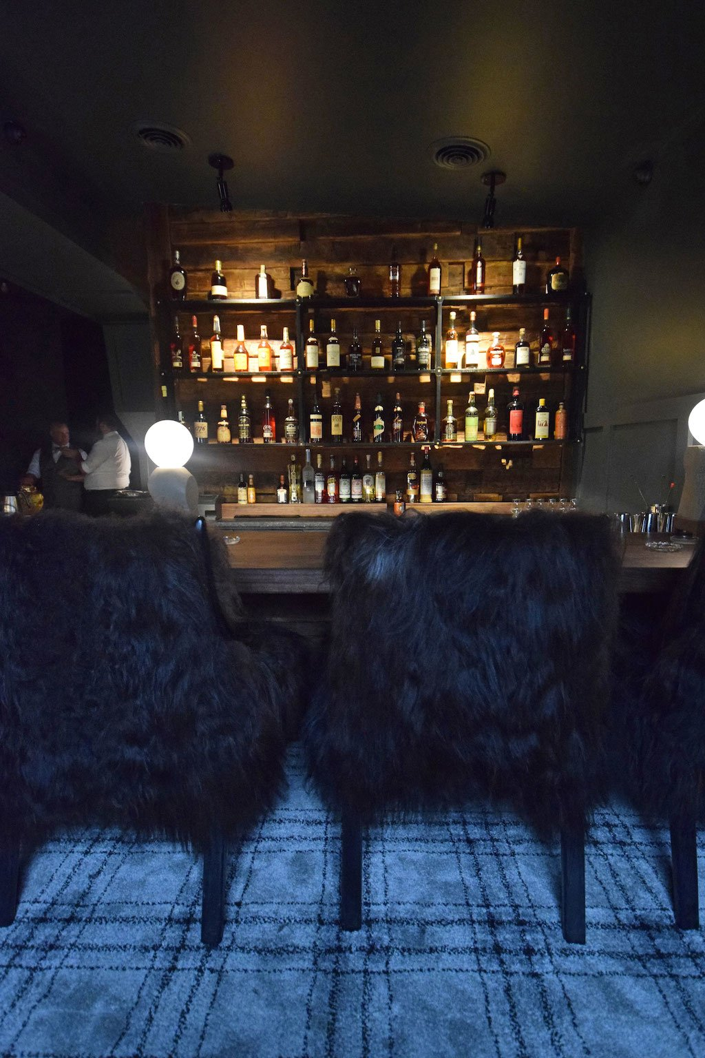 Icelandic sheepskin chairs are the comfiest bar seats in town.