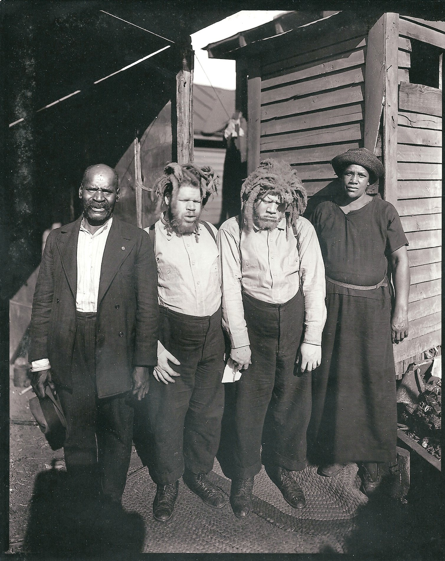 Harriett Muse, right, and husband Cabell, far left, with the brothers shortly after she found them at a sideshow in 1927. Photograph by George Davis, courtesy of Frank Ewald