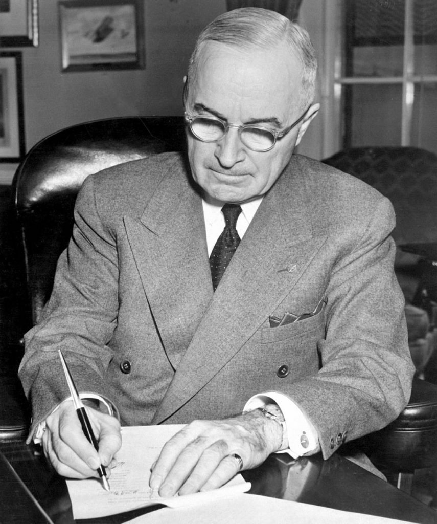 President Harry S. Truman signing a proclamation declaring a national emergency, December 16, 1950. Photo by Department of Defense \wikimediacommons