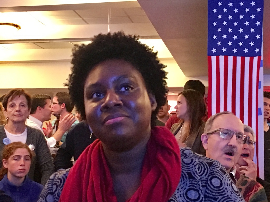 """Anika Harden, from DC, at the Sixth and I viewing party. """"I think Hillary is going to win, but I wish they would say it already,"""" she says. """"I am about to lose my mind."""""""
