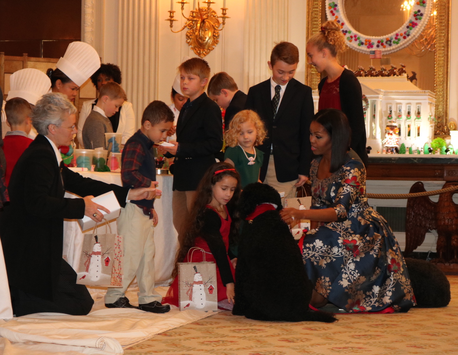 First Lady Michelle Obama meets with kids at the 2016 White House Christmas. Photo by Sydney MaHan.