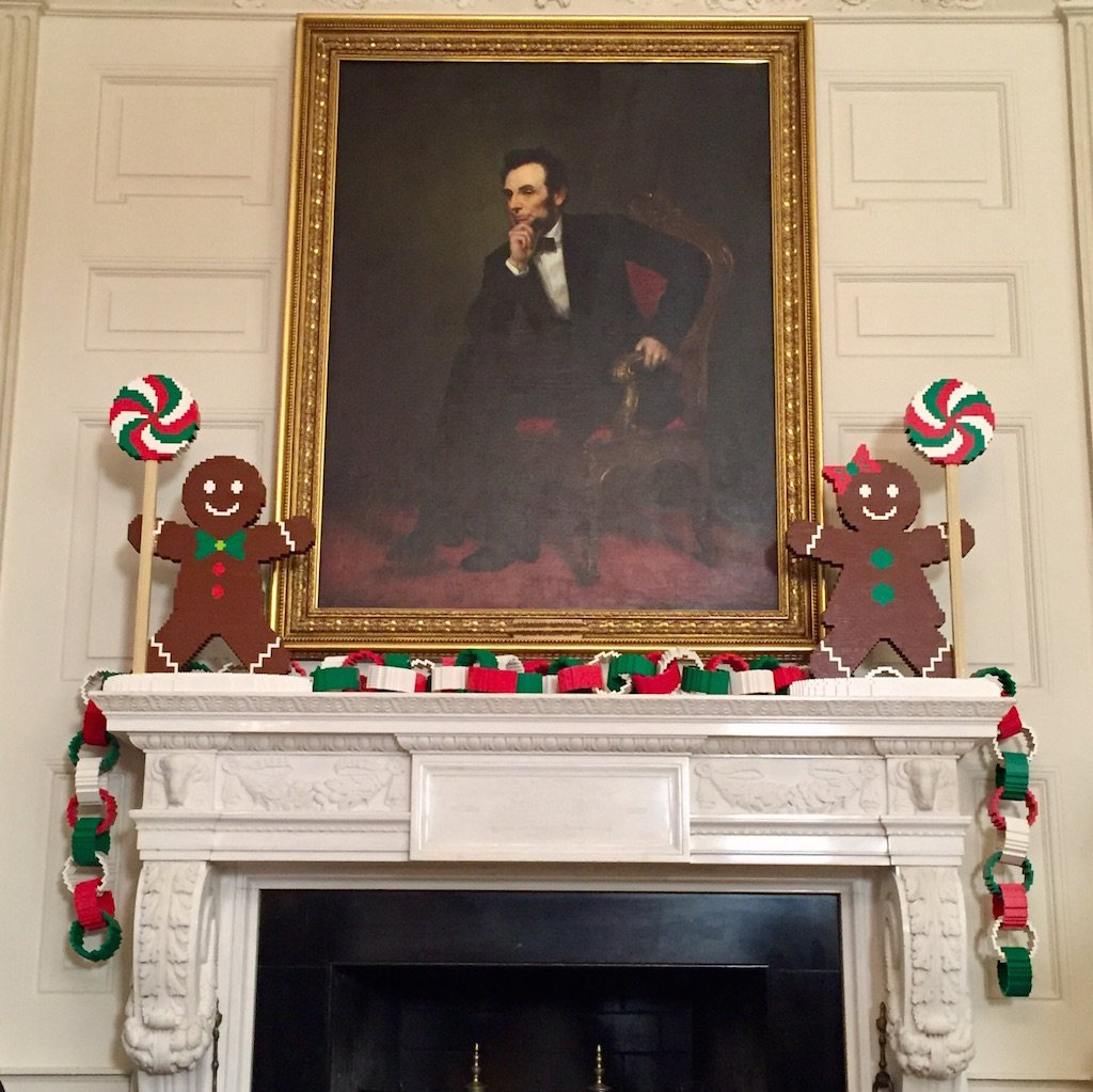 Painting of Abraham Lincoln framed by lego gingerbread men. Photo by Andrea Marks.