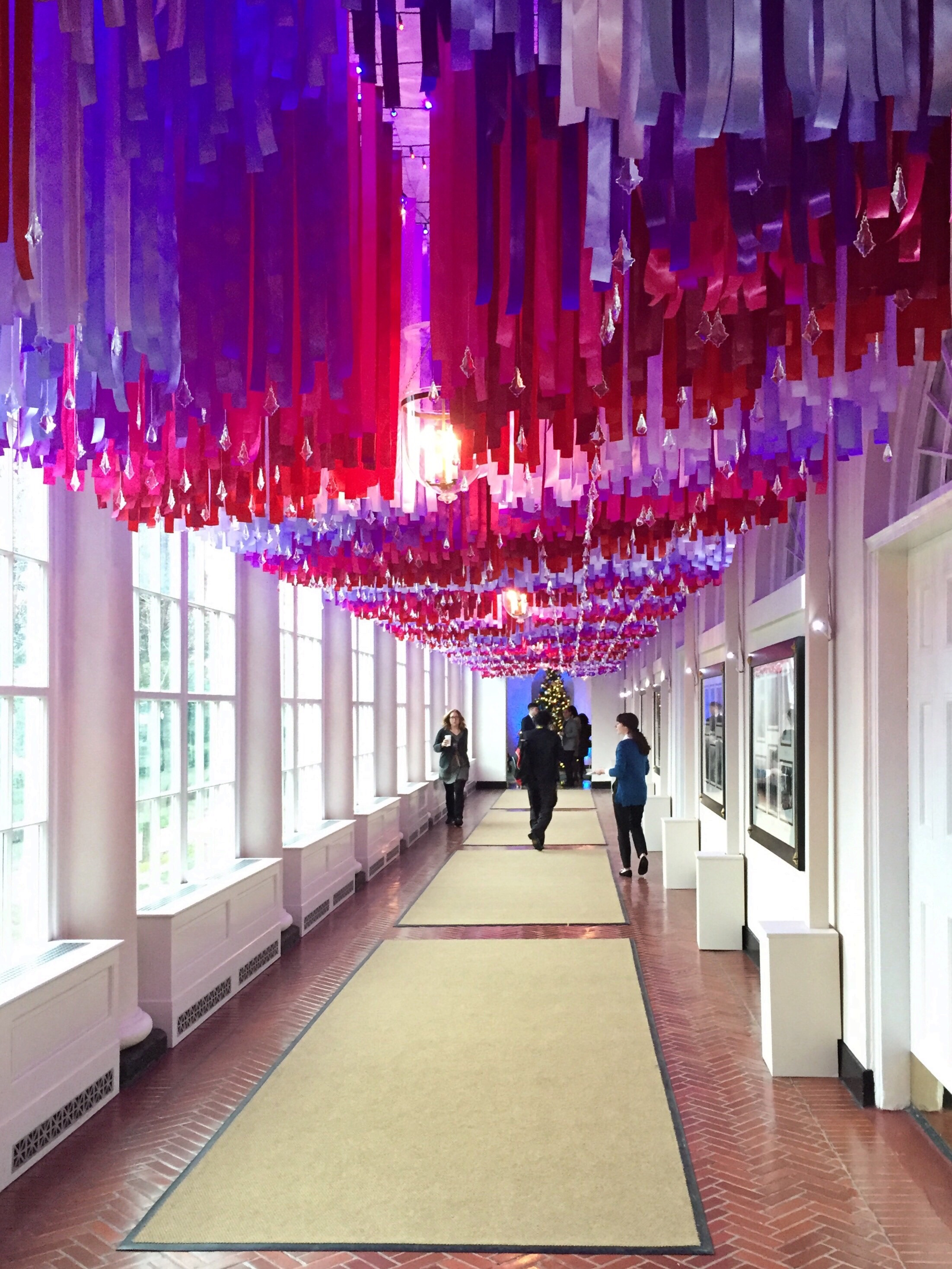 More than 7.500 red,white, and blue ribbons hanging in the East Colonnade of the White House. Photo by Andrea Marks.