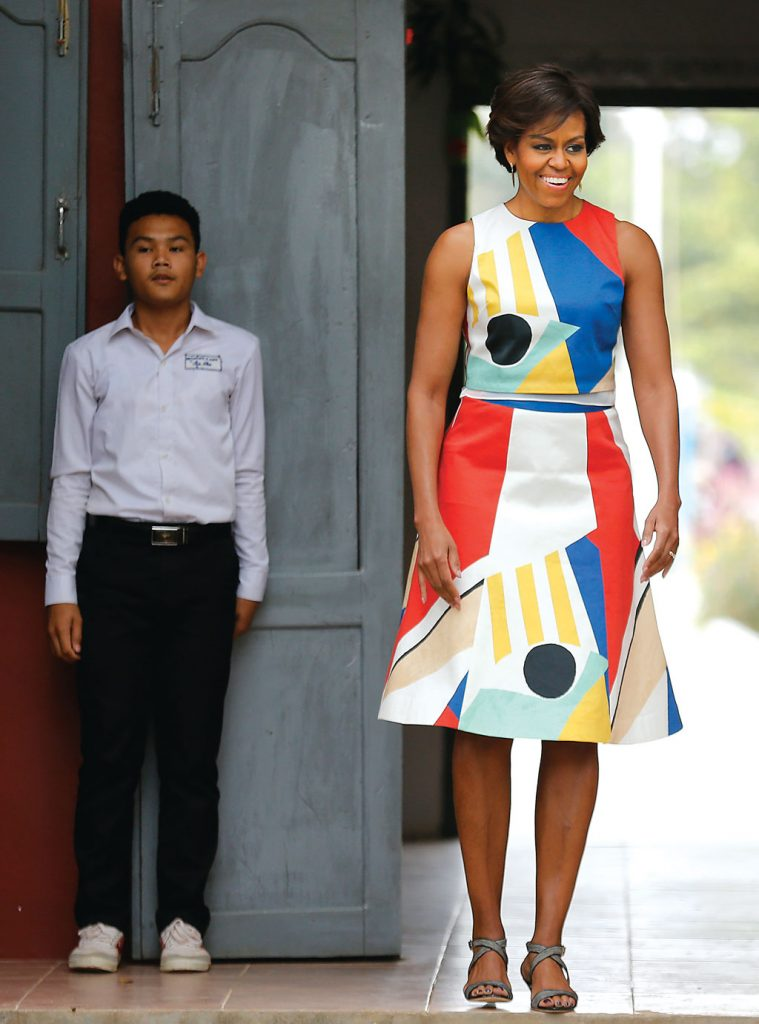 Michelle Obama wore this sleeveless sheath during a visit to a school in Siem Reap province, Cambodia on March 21, 2015. Photo by AP Images.