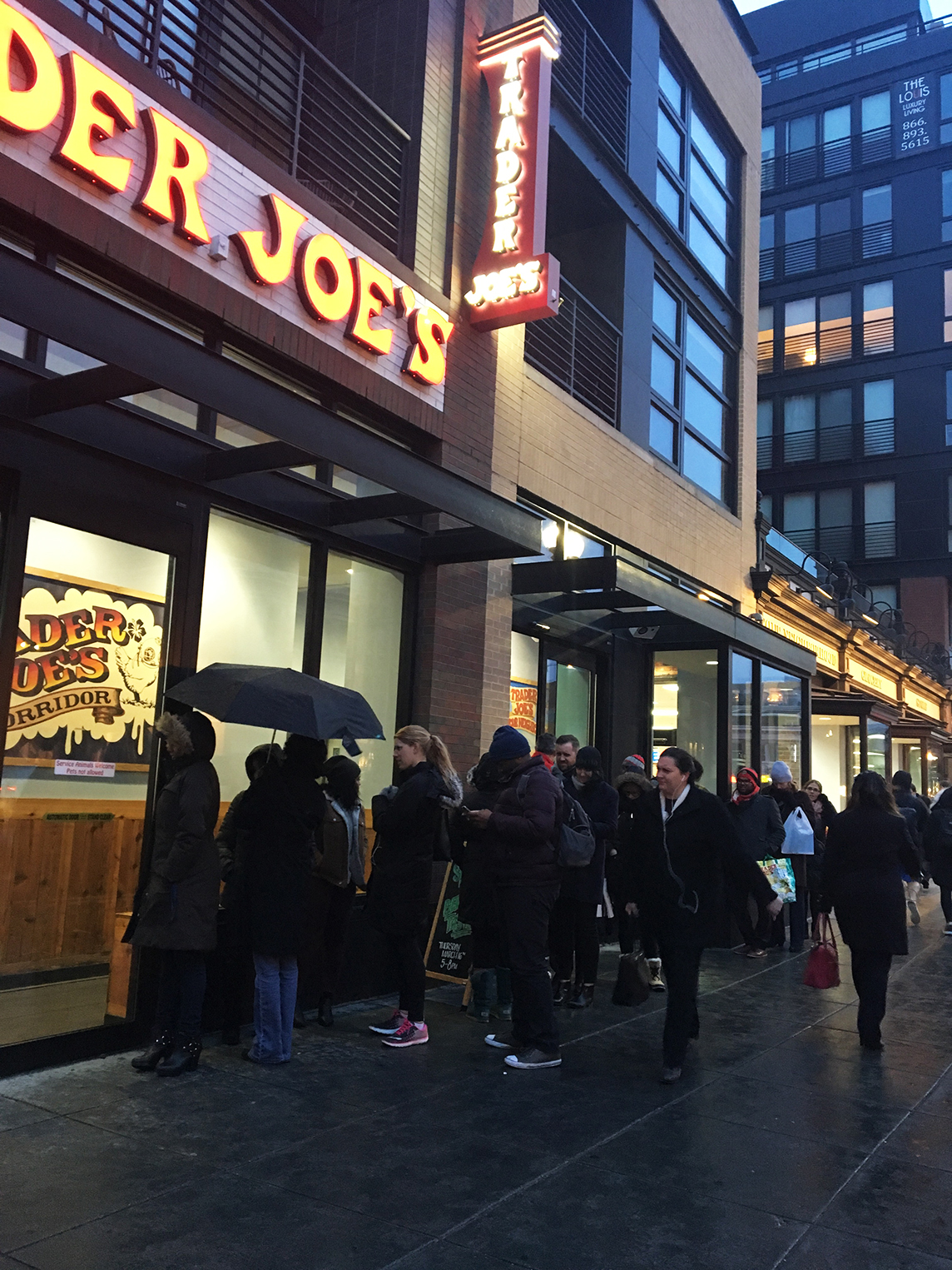 Washingtonians lining up outside of the Shaw Trader Joe's to stock up on snow day supplies. Photograph by Julie Strupp.