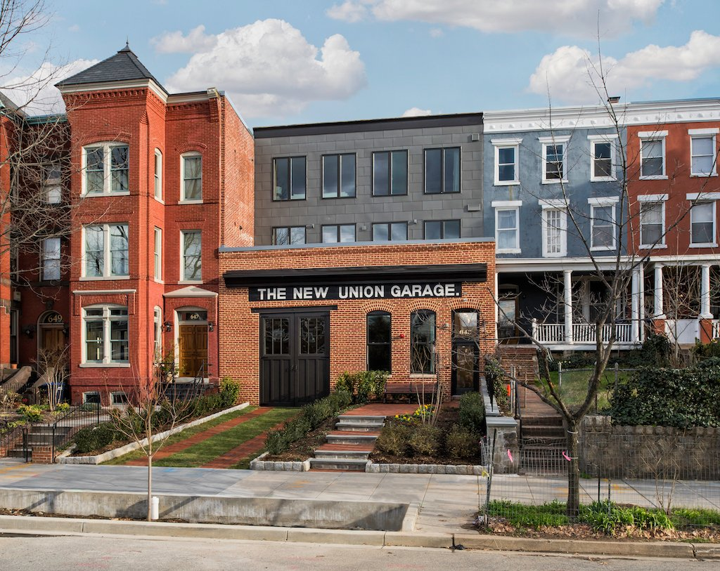 look inside this century old capitol hill car garage turned condos the developer added two floors atop the original building and commissioned an artist to recreate the historic new union garage sign