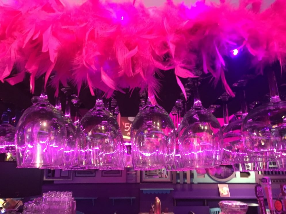 Crystal City's Center Of LGBTQ Life Is a Purple Beach Bar–With Barbies