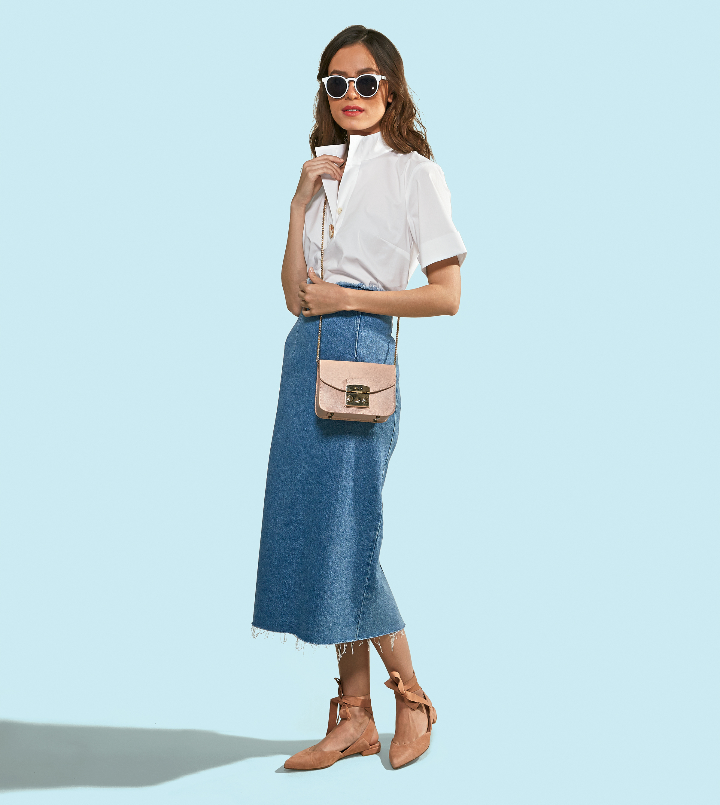 a0d0c6775366 A high-waisted pencil skirt offers the perfect amount of leg coverage for casual  Friday. Denim pencil skirt