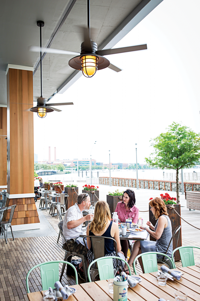 A patio overlooks the Anacostia River.