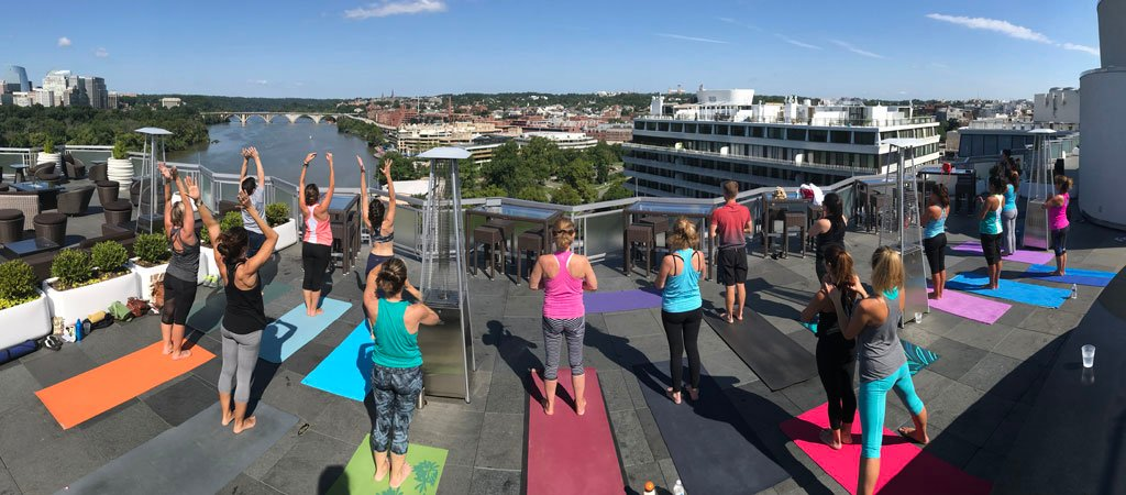 A Rooftop Yoga Class At The Watergate Hotel Comes With