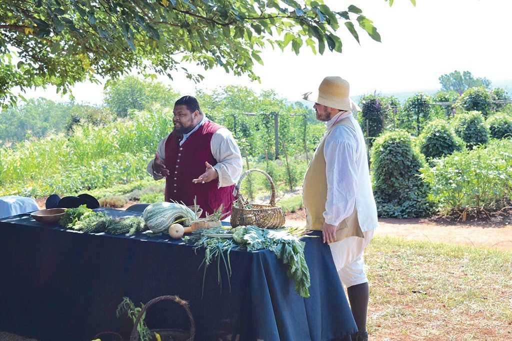 Twitty prepares okra soup and barbecue cottontail rabbit on Mulberry Row, former site of Monticello's slave quarters. Photograph courtesy of Michael Twitty.