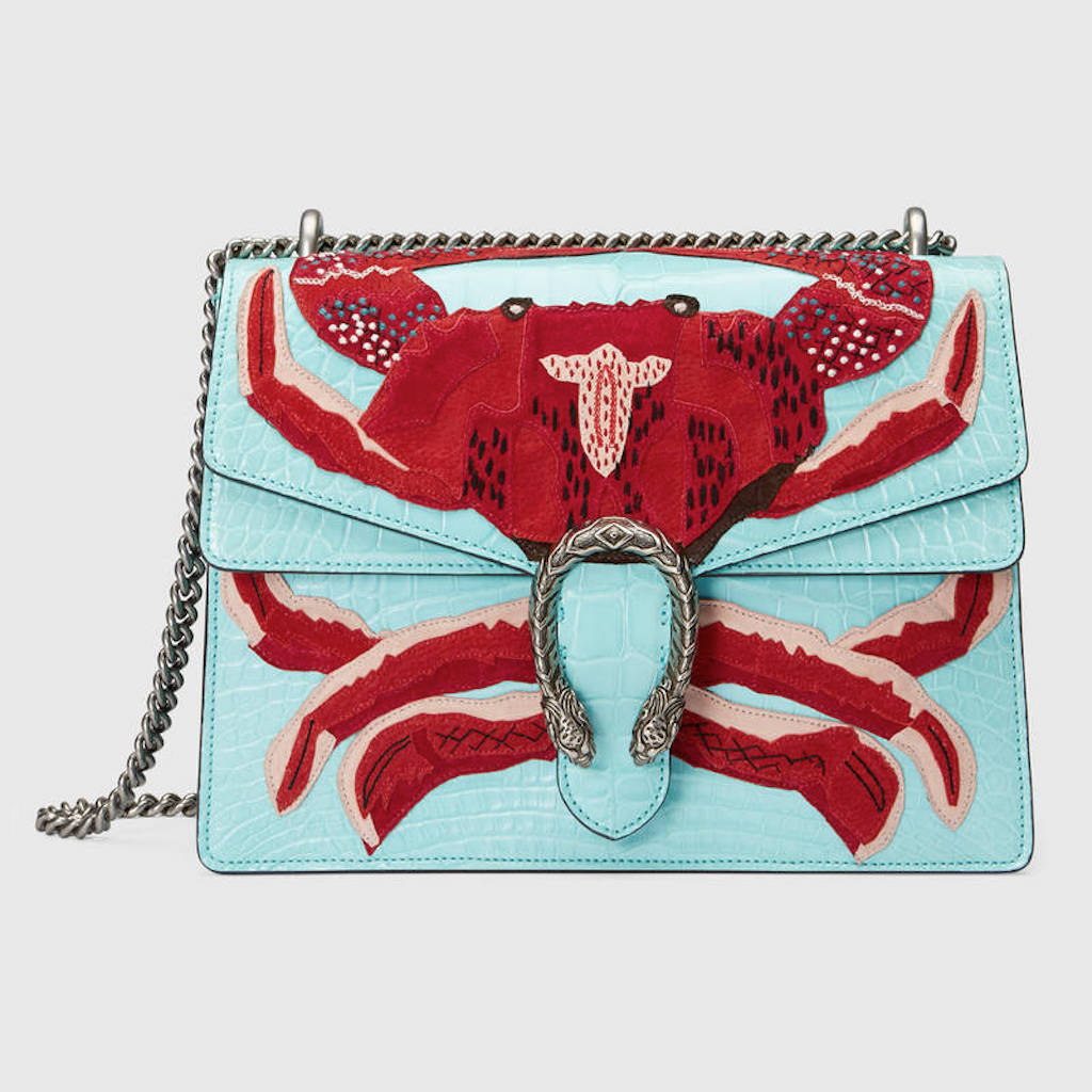 71b5fd900de Why pay off your student loans when you can have a crab-adorned Gucci bag   (Kidding.) This purse is by far the most luxurious and fiscally out-of-reach  ...
