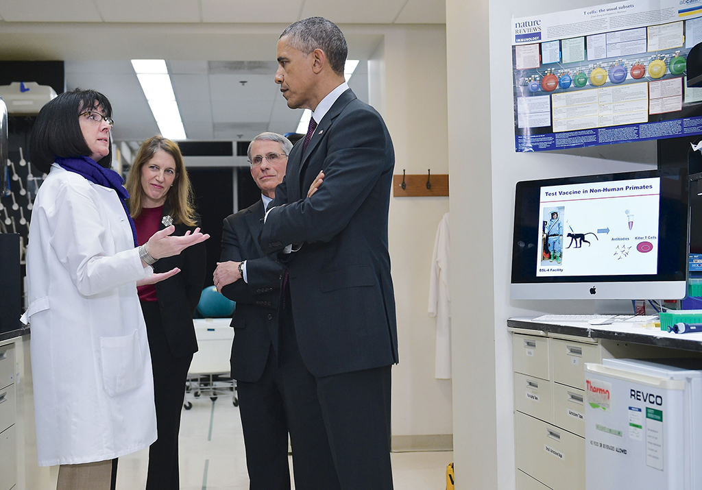 Sounds of science: Ebola researcher Nancy Sullivan, Burwell, National Institute of Allergy and Infectious Diseases director Anthony Fauci, and President Obama. Photograph by Mandel Ngan/AFP/Getty Images.